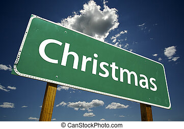 Christmas Road Sign with Dramatic Clouds