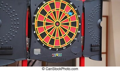 color target for game in darts and darts flying to it