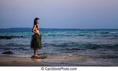 Indigene woman in the palm skirt, seashells necklace and...