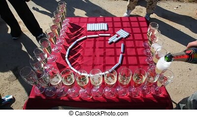 Glasses with champagne stand on table near chocolate