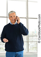 Casual Businessman with Cell Phone - Closeup of a casual...