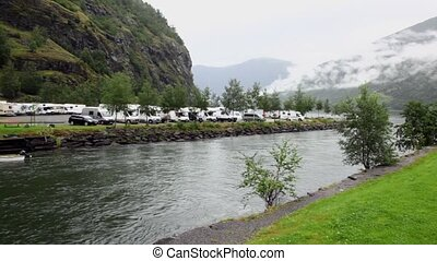 Camping on shore of river which flow into fiord near...