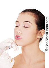 Cosmetic botox injection in the female face, lips zone