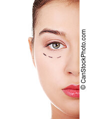 Woman marked out for cosmetic surgery Isolated on white