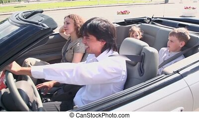 Buckle up family ride in cabriolet at sunny summer day,...