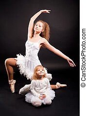 Two pretty ballerinas - Young attractive ballerina with 2...