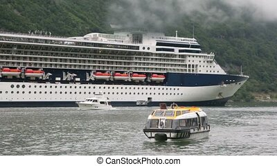 Passengers transport boat float away from huge liner near...