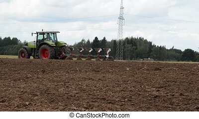 tractor plow field stork - tractor plow field in autumn and...