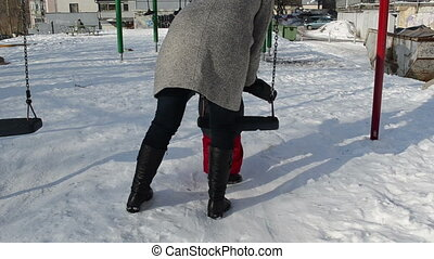 winter swing daughter - winter afternoon a mother with her...
