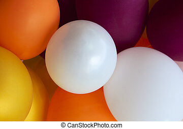 many colored balloons forming a bright background