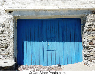 Fisherman's boat house door, Andros island, Greece