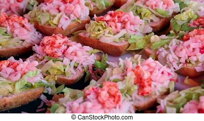 Many sandwiches with seafoods, closeup view in motion