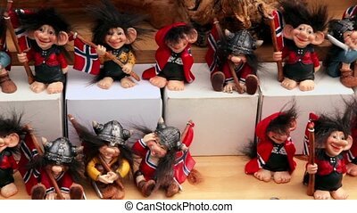 Many toy vikings with flags of Norway at showcase, shown in...