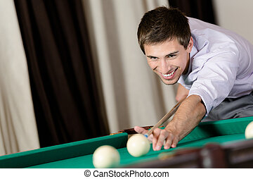 Man playing billiard at club