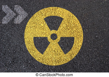 Nuclear sign - Nuclear warning symbol on asphalt surface