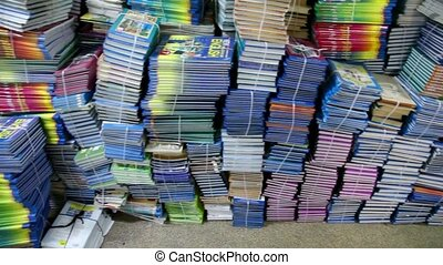 Many books lie at pile in bright room, shown in motion
