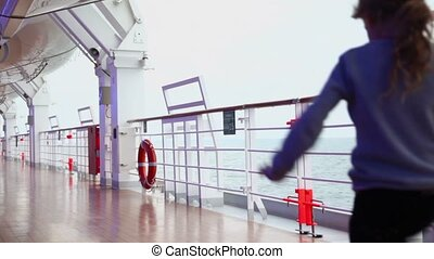 Mother and her daughter walk by deck near fence during cruise