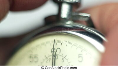 man starting and stopping stopwatch close-up. time concept