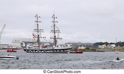 Tows accompany sailing vessel Stavros S Niarchos in harbor -...