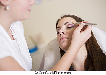 Make up salon - Make up artist doing professional make up of...