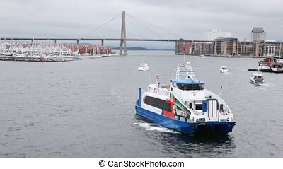 Walking ship floats on gulf of Stavanger against bridge -...