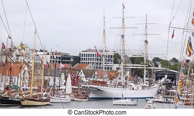Three-mast Norwegian sailing ship stands in port of...