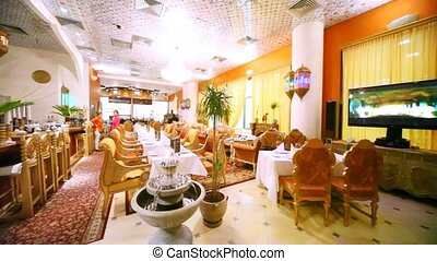 Interior of restaurant lounge is made in Indian style