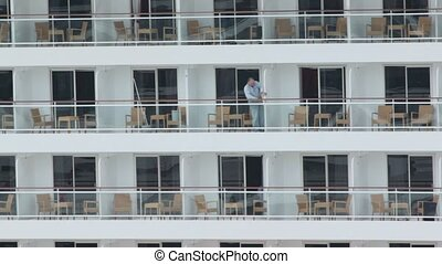Worker closes partitions between balconies on cruiser -...