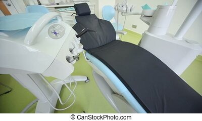 Dental chair and other equipment in surgery, upward motion
