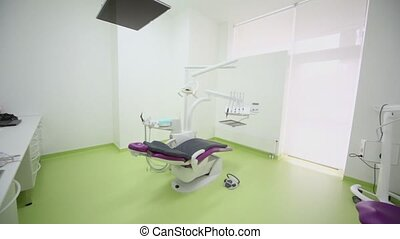 Dental chair with tv set above and other medical equipment...