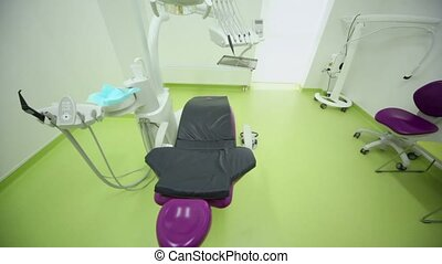Chair and many medical equipment in dental surgery
