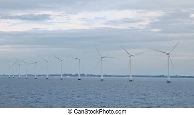 Several windmills for electric energy generation in sea near...