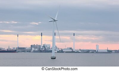 Windmill for electric energy generation in sea near plant -...