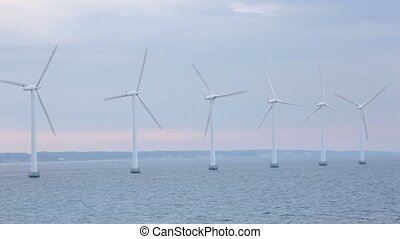 Six windmills for electric energy generation in sea near...
