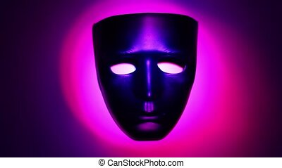 Black theatrical mask in ring of color light which changes