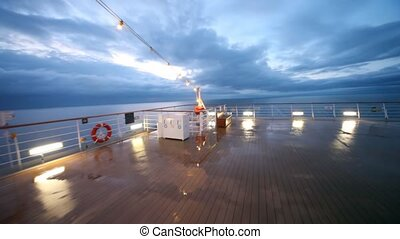 movement on empty ship stern to handrail in evening in...