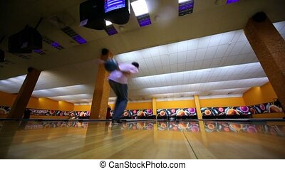 Man throws bowling ball and makes strike by beats all tenpins