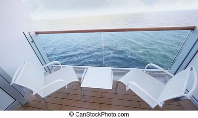 enclosed part of ship deck with two chairs and table