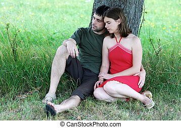 Couple under tree - Couple is resting under tree