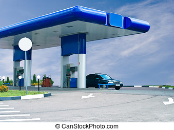 gas refuel station against cloudy sky