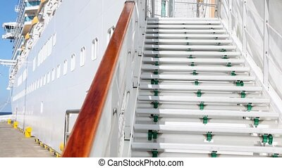 steps leading to an entrance in big passenger ship in port