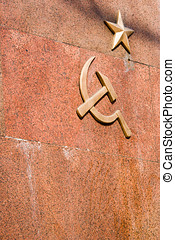 Soviet military emblem on granite wall