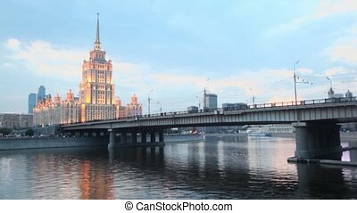 Traffic on Novoarbatsky bridge at quay with skyscrapers of...