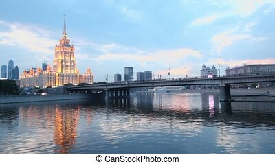 Traffic on Novoarbatsky bridge and quay with high-rise...