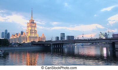 Ship floats near Novoarbatsky bridge with high-rise building...