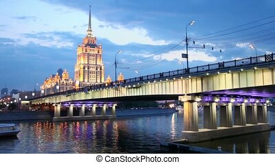 Ship floats near Novoarbatsky bridge with skyscrapers of...