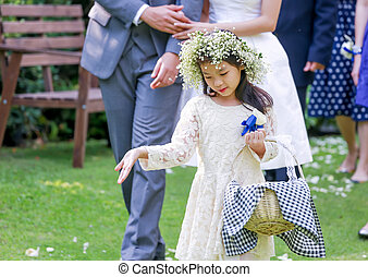 Cute little flower girl in the wedding ceremony