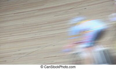 Group of bicyclists pass by track during race, closeup view