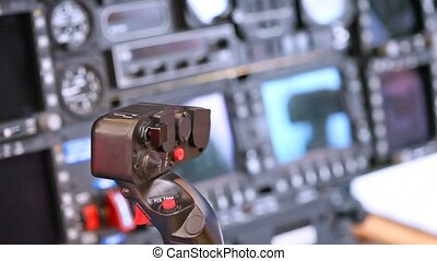 Control lever by helicopter stands against control panel