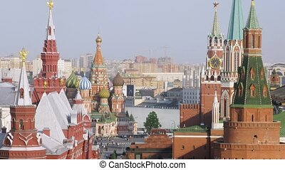 Towers of Kremlin stand against blue sky, time lapse